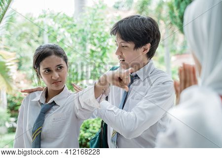 Close Up Of An Indonesian High School Girl Angry With Finger Pointing And Her Male Friend Broke Up