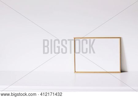 Golden Horizontal Frame On White Furniture, Luxury Home Decor And Design For Mockup Creations