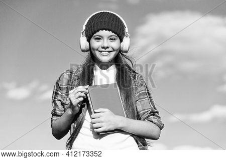 Learn Language Different Way. Happy Child Wear Headphones On Blue Sky. Audio Book. Listening And Rea