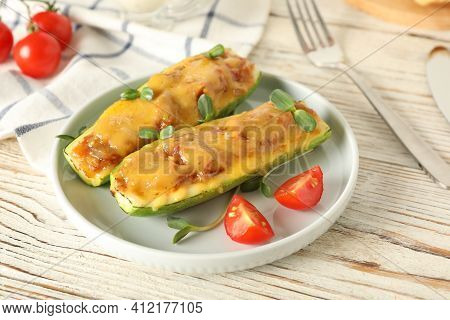 Baked Stuffed Zucchinis Served On White Wooden Table, Closeup