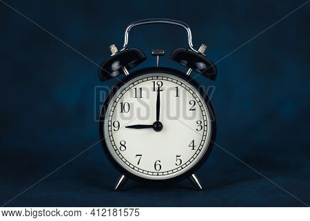 The Time Is Nine O'clock In The Morning. Time - 09-00. Retro Clock. Dark Background. Time To Work. C