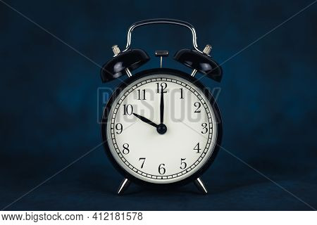 It's Ten O'clock In The Morning. Time - 10-00. Retro Clock. Dark Background. Time To Work. Copy Spac