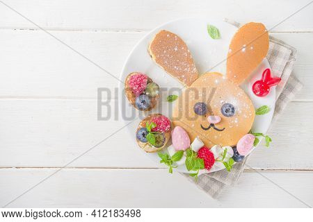Funny Bunny Pancakes, Cute Kids Breakfast For Easter Morning. Creative Rabbits Pancakes With Fresh B