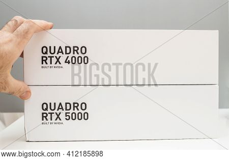 Paris, France - Mar 28, 2019: Male Hand On The Packaging Of Two New Gpu Nvidia Quadro Rtx 4000 And R