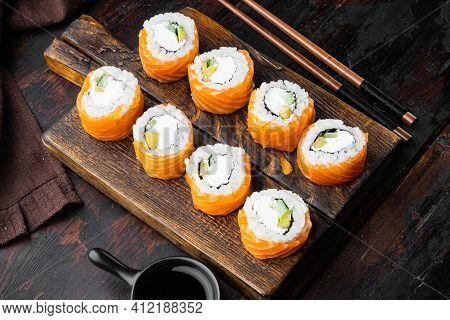 Uramaki. Philadelphia Classic. Salmon, Philadelphia Cheese, Cucumber Set, On Old Dark  Wooden Table