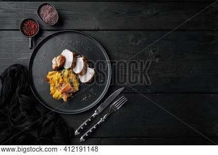 Roasted Pork Loin With Mash Potatoe Gratin, Sage And Prosciutto Set, On Plate Dish, On Black Wooden
