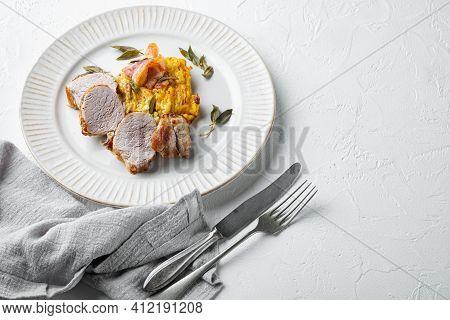 Roasted Pork Loin With Mash Potatoe Gratin, Sage And Prosciutto Set, On Plate Dish, On White Stone