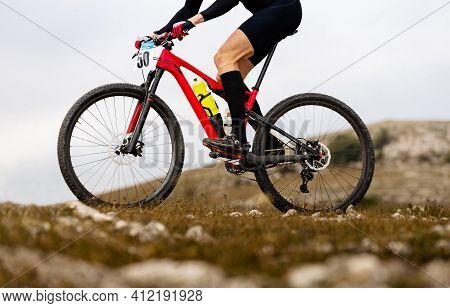 Close Up Male Cyclist On Mountainbike Riding On Mountain Trail
