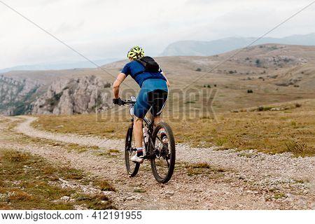 Man Cyclist Biking On Mountain Path On Mountain Bike
