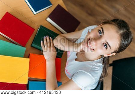 Back To School, Reading Book, Education, Library Concept. Student Girl With Book On Background Of Bo