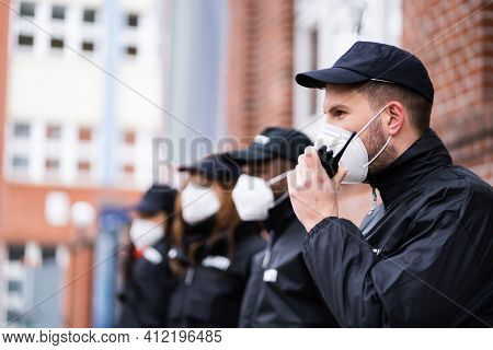 Security Officer Staff Group At Event In Face Mask