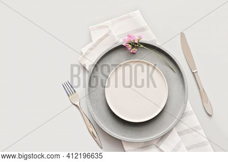 Empty Grey Plates On A Table With Fork And Knife. Spring Menu Concept. Trendy Nordic Minimal Style T