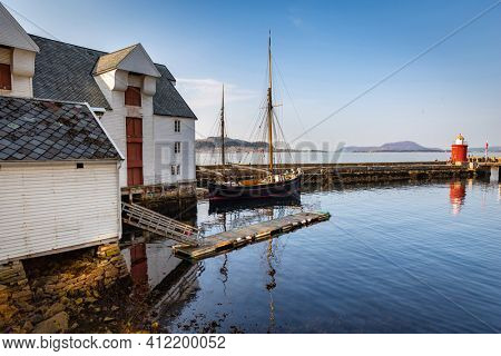 Alesund, Norway - April 14, 2018: Architecture at the harbor of Alesund city at sunny day, Norway. Alesund is a town and municipality in west Norway.