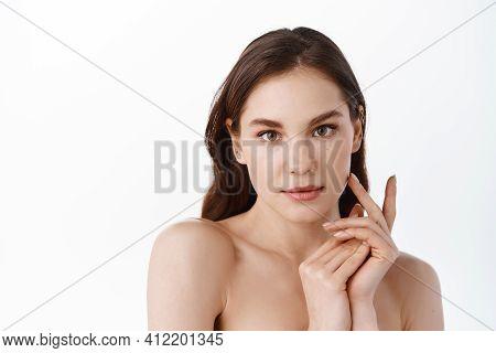 Skin Care. Woman With Beauty Face Touching Healthy Facial Skin Portrait. Beautiful Smiling Girl Mode