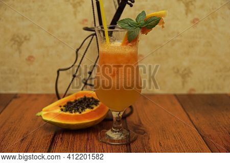 Non-alcoholic Papaya And Lime Cocktail.colorful Non- Alcoholic Cocktails Arranged In Glasses