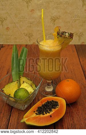 Tropical Non-alcoholic Cocktail With Pineapple Lime Papaya Orange. Colorful Non- Alcoholic Cocktails
