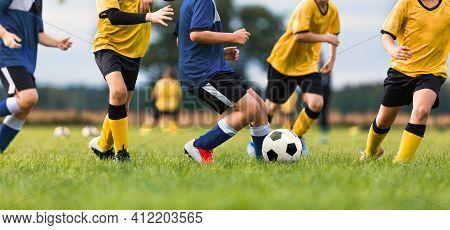 Children Playing Football Toruanment Game. Happy Kids Kicking Soccer Ball. Group Of School Kids Trai