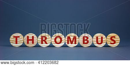 Medical And And Thrombus Symbol. Wooden Circles With The Word 'thrombus'. Beautiful Grey Background.