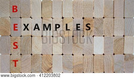 Best Examples Symbol. Woden Blocks With Words 'best Examples'. Beautiful Wooden Background. Business