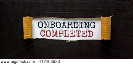 Onboarding Completed Symbol. Words 'onboarding Completed' Appearing Behind Torn Black Paper. Beautif