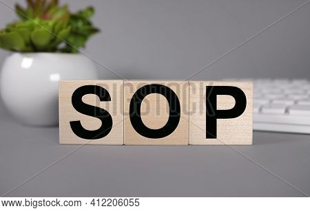 Sop . Standard Operating Procedure. Conceptual Image. Text On Wood Cubes. Text In Black Letters On W