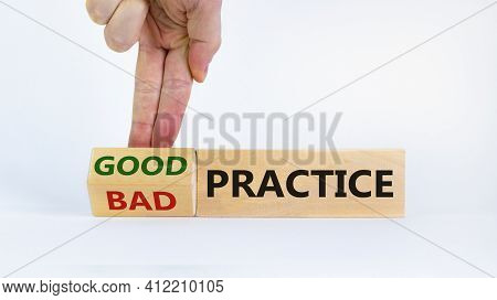 Good Or Bad Practice Concept. Businessman Turns A Block And Changes Words 'bad Practice' To 'good Pr