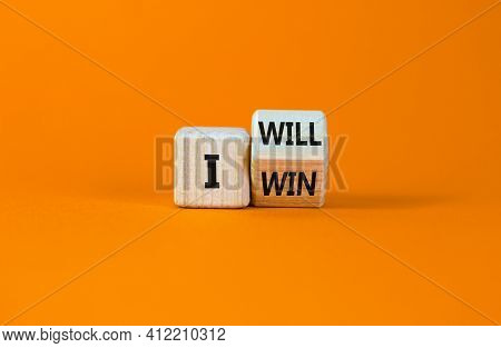 I Will Win Symbol. Turned A Wooden Cube And Changed Words I Will To I Win. Beautiful Orange Backgrou