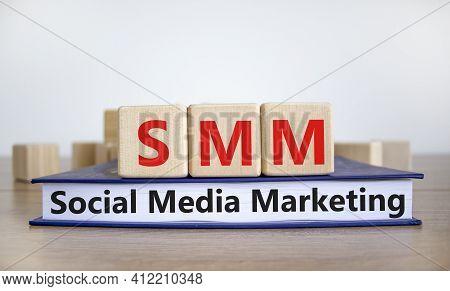 Smm, Social Media Marketing Symbol. Wooden Cubes On Book With Word 'smm - Social Media Marketing' On