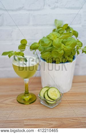 Cucumber Gin Basil Crash In Glass. Tasty And Fruity Cocktails Served In Glasses