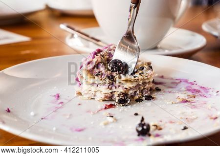 A Piece Of Honey Cakes, Consisting Of Many Layers And Purple Cream. Napoleon Cake With Black Currant