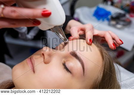 Laser Removal Of Permanent Makeup On The Face. Close-up Of A Young Woman Getting Tattoo Correction.