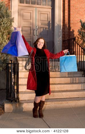 Happy Young Woman Showing Shopping Bags