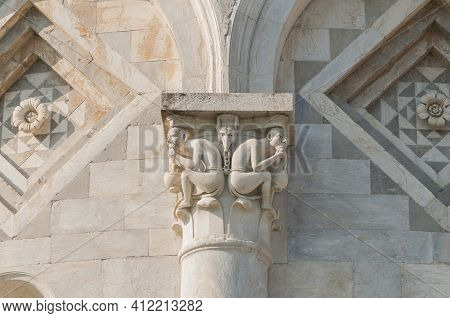 Leaning Tower Of Pisa: Detail Of A Capital Depicting Two Demons Bound By A Monstrous Creature