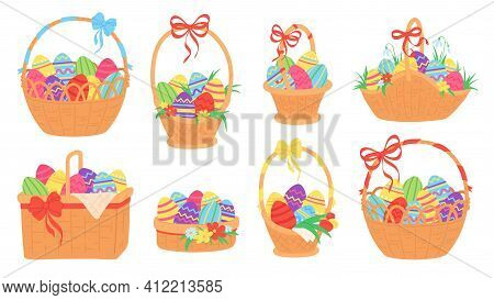 Easter Baskets. Painted Chocolate Eggs In Wicker Basket With Ribbon, Grass, Tulip And Snowdrop Flowe