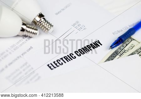 Abstract American Electricity Bill. Concept Of Saving Money By Using Energy Savings Led Light Bulbs