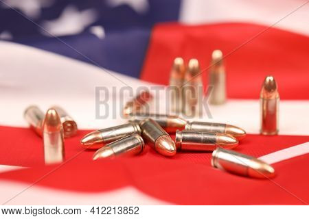Many Yellow 9mm Bullets And Cartridges On United States Flag. Concept Of Gun Trafficking On Usa Terr