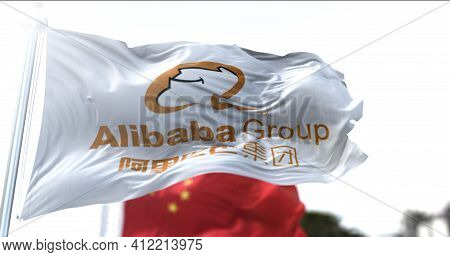Hangzhou, China, March 12 2021: Flag With The Alibaba Group Logo Flying Along With The National Flag