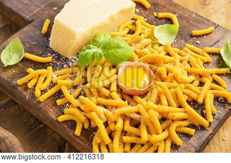 Traditional Pasta Cooked In Chicken Broth , Fresh Pasta. Passatelli In Brodo. A Pasta Formed Of Eggs