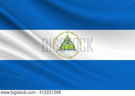 Flag Of Nicaragua. Fabric Texture Of The Flag Of Nicaragua.