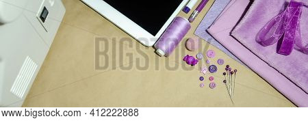 Online Courses Concept. Sewing Courses On Sewing Machine With Copy Space. Purple Sewing Accessories