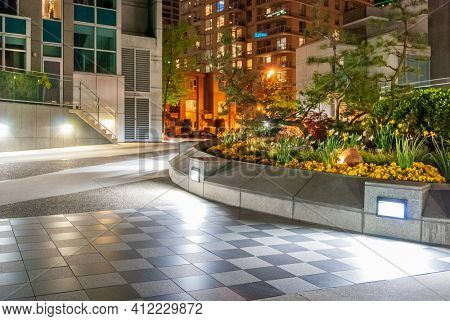 Outdoor landscape garden at night in Downtown of Vancouver, Canada.