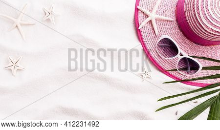 Top View Of Beach Sand With Shells, Coconut Leave, Beach Hat And Starfish. Summer Background Concept