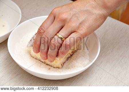 Hand Passing In Grated Coconut Traditional Brazilian Dessert Called In Brazilian Portuguese: Bolo Ge