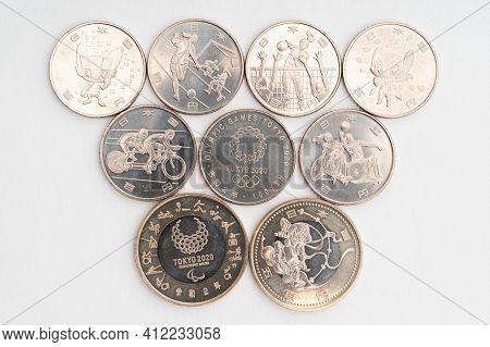Tokyo, Japan - January 4, 2021: Commemorative Coins Of 100 Yen And 500 Yen For The Tokyo 2020 Olympi