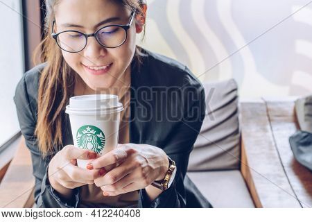 Chiang Mai, Thailand : May-15-2019 : Business Asian Woman Taking A Break With A Cup Of Starbucks Cof