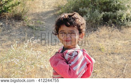 A Young Boy Of Indian Origin Standing In The Garden Expressing His Sourness. Concept For Today's Chi