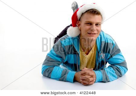 Male Wearing Christmas Hat And Looking At You