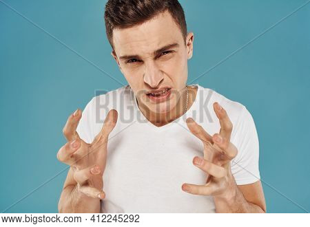 Man In White T-shirt Cropped View Of Emotion Displeasure Studio