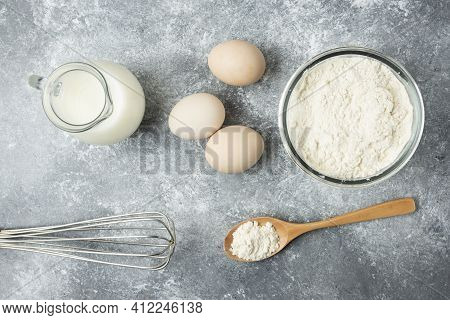 Bowl Of Flour, Eggs And Whisker On Marble Background