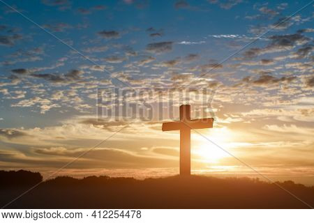 Silhouette Of Catholic Cross, Crucifixion Of Jesus Christ At Sunset Background.